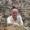 A little tiger in the Tiger Temple in Thailand.  There with the teachers I taught with, good times! - Pinay Romances Dating